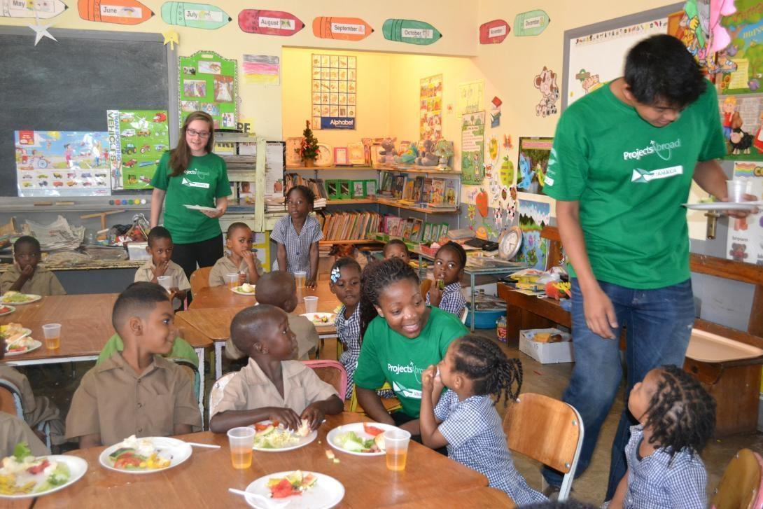 Childcare volunteers prepare a nutritious breakfast for children at a Care placement in Jamaica